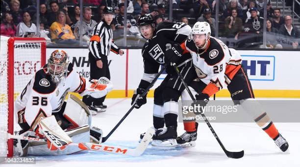 Goaltender John Gibson and Marcus Pettersson of the Anaheim Ducks battle for position with Dustin Brown of the Los Angeles Kings during the first...