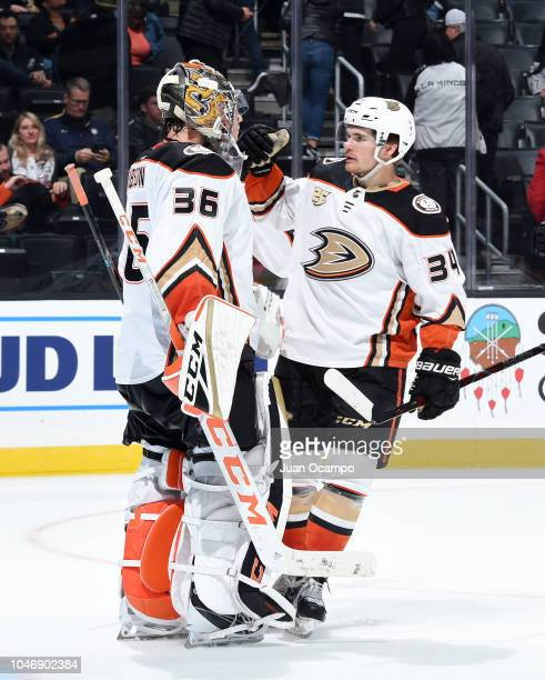 Goaltender John Gibson and Sam Steel of the Anaheim Ducks embrace after defeating the Los Angeles Kings 30 in the preseason game at STAPLES Center on...