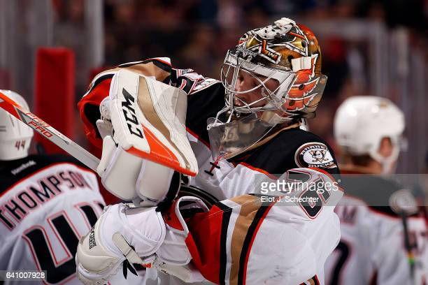 Goaltender John Gibson of the Anaheim Ducks adjusts his gear during a break in the action against the Florida Panthers at the BBT Center on February...