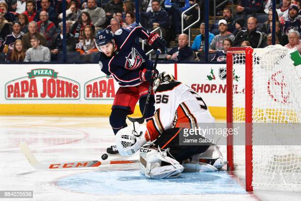Goaltender John Gibson of the Anaheim Ducks blocks a shot taken by Josh Anderson of the Columbus Blue Jackets during the third period of a game on...