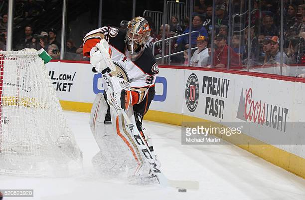 Goaltender John Gibson of the Anaheim Ducks clears the puck against the Colorado Avalanche at the Pepsi Center on April 9 2016 in Denver Colorado The...