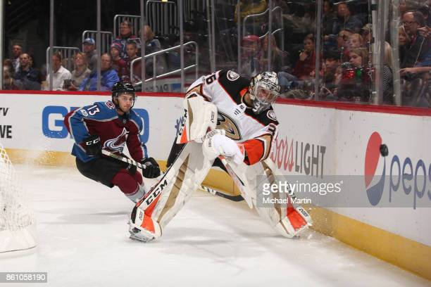 Goaltender John Gibson of the Anaheim Ducks clears the puck against the Colorado Avalanche at the Pepsi Center on October 13 2017 in Denver Colorado