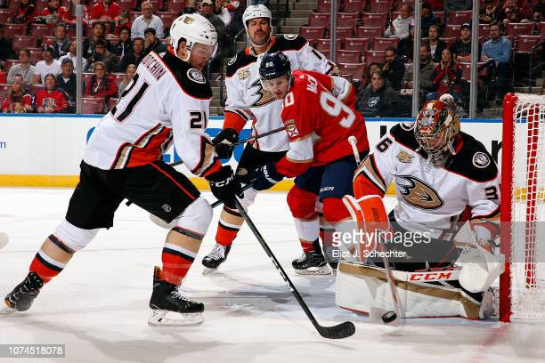 Goaltender John Gibson of the Anaheim Ducks defends the net with the help of teammate Jake Dotchin against the Florida Panthers at the BBT Center on...