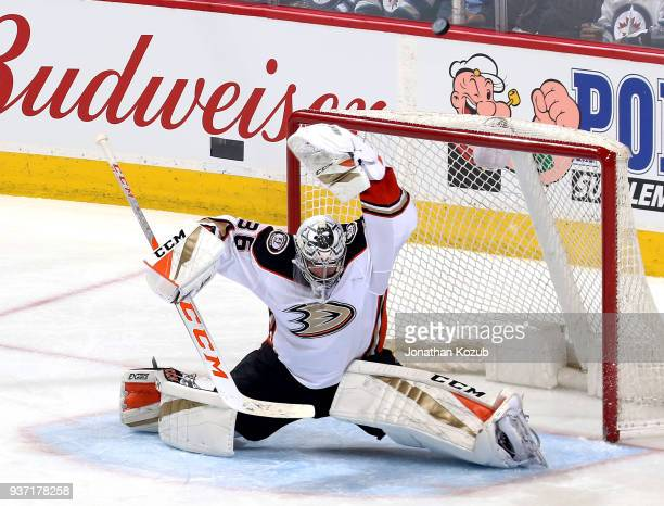 Goaltender John Gibson of the Anaheim Ducks does the splits in the crease as the puck flies over the net during second period action against the...