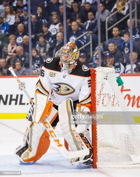 Goaltender John Gibson of the Anaheim Ducks guards the net during first period action against the Winnipeg Jets at the Bell MTS Place on January 13...