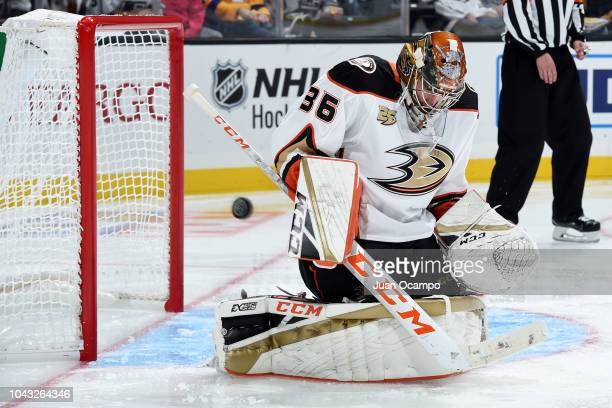 Goaltender John Gibson of the Anaheim Ducks makes the save against the Los Angeles Kings during the third period of the preseason game at STAPLES...