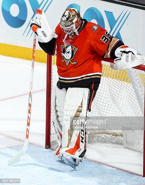 Goaltender John Gibson of the Anaheim Ducks reacts after allowing the third of three goals during the second period of the game against the Los...