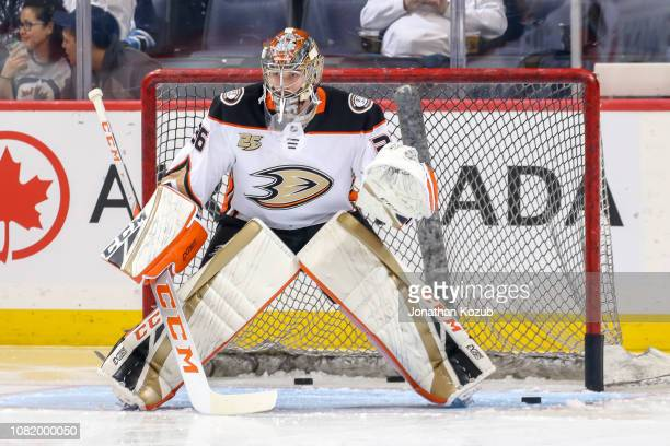 Goaltender John Gibson of the Anaheim Ducks takes part in the pregame warm up prior to NHL action against the Winnipeg Jets at the Bell MTS Place on...