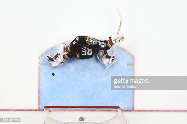 Goaltender John Gibson of the Anaheim Ducks tries for the blocker save as the puck goes off the post in the second period of Game Two of the Western...