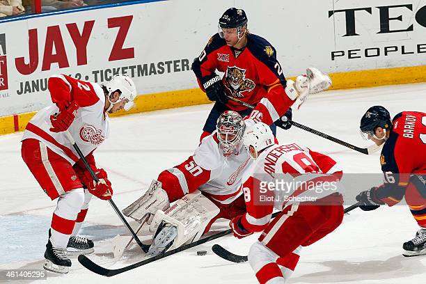 Goaltender Jonas Gustavsson of the Detroit Red Wings defends the net against the Florida Panthers at the BBT Center on December 28 2013 in Sunrise...