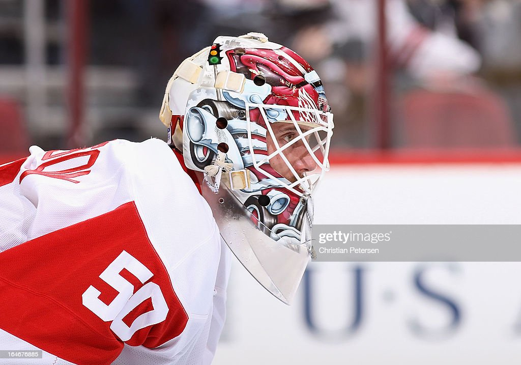 Goaltender Jonas Gustavsson #50 of the Detroit Red Wings looks down ice during the NHL game against the Phoenix Coyotes at Jobing.com Arena on March 25, 2013 in Glendale, Arizona. The Red Wings defeated the Coyotes 3-2.