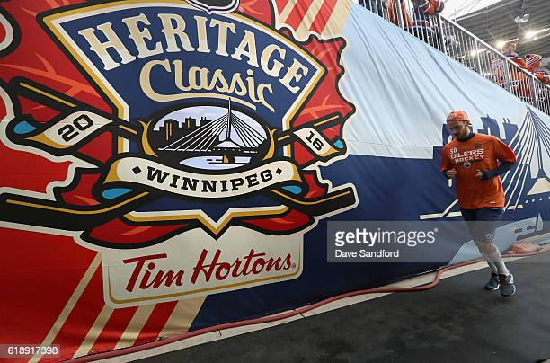 Goaltender Jonas Gustavsson of the Edmonton Oilers warms up before playing against the Winnipeg Jets in the 2016 Tim Hortons NHL Heritage Classic at...