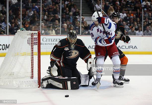 Goaltender Jonas Hiller of the Anaheim Ducks makes a save as Derick Brassard of the New York Rangers and Ben Lovejoy of the Ducks pursue the play in...