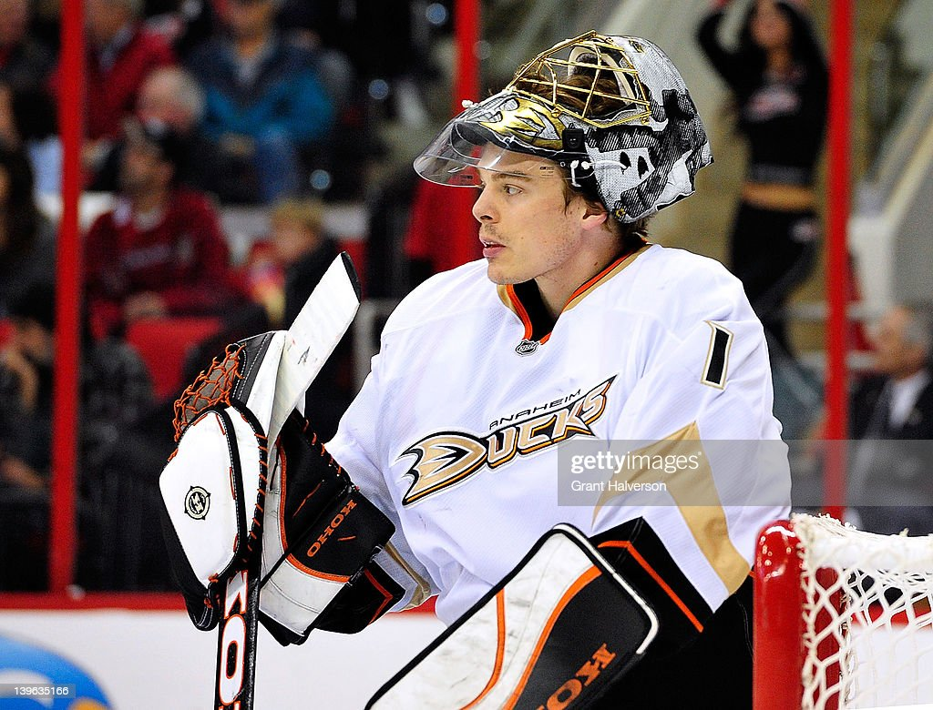 Goaltender Jonas Hiller #1 of the Anaheim Ducks pauses during a break in the action against the Carolina Hurricanes at the RBC Center on February 23, 2012 in Raleigh, North Carolina.