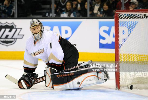 Goaltender Jonas Hiller of the Anaheim Ducks watches the puck bounce out of the net after a goal scored by Jamie McGinn of the San Jose Sharks at HP...