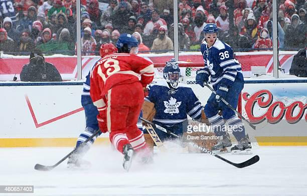 Goaltender Jonathan Bernier and Carl Gunnarsson of the Toronto Maple Leafs defend their net during the 2014 Bridgestone NHL Winter Classic on January...
