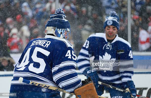 Goaltender Jonathan Bernier and Nazem Kadri of the Toronto Maple Leafs warm up prior to the 2014 Bridgestone NHL Winter Classic on January 1 2014 at...