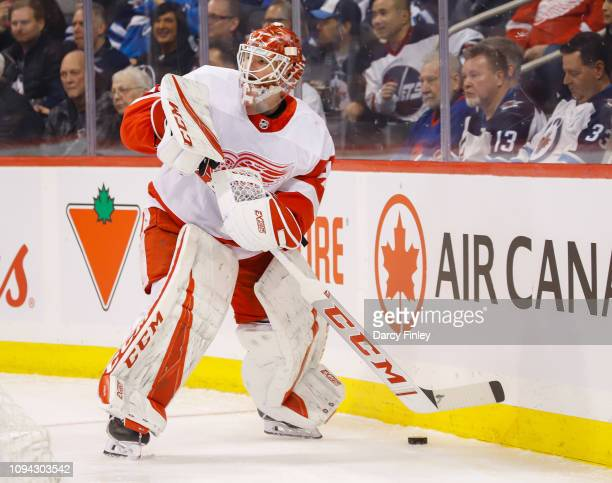 Goaltender Jonathan Bernier of the Detroit Red Wings plays the puck behind the net during first period action against the Winnipeg Jets at the Bell...