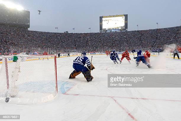 Goaltender Jonathan Bernier of the Toronto Maple Leafs defends his net in overtime during the 2014 Bridgestone NHL Winter Classic on January 1 2014...