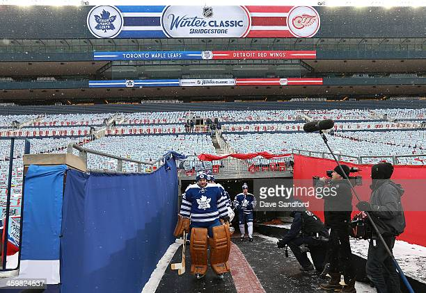 Goaltender Jonathan Bernier of the Toronto Maple Leafs leads the way for his teammates to the ice during the 2014 Bridgestone NHL Winter Classic team...