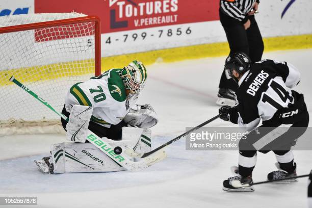 Goaltender Jonathan Lemieux of the ValdOr Foreurs makes a save on Antoine Demers of the BlainvilleBoisbriand Armada during the QMJHL game at Centre...