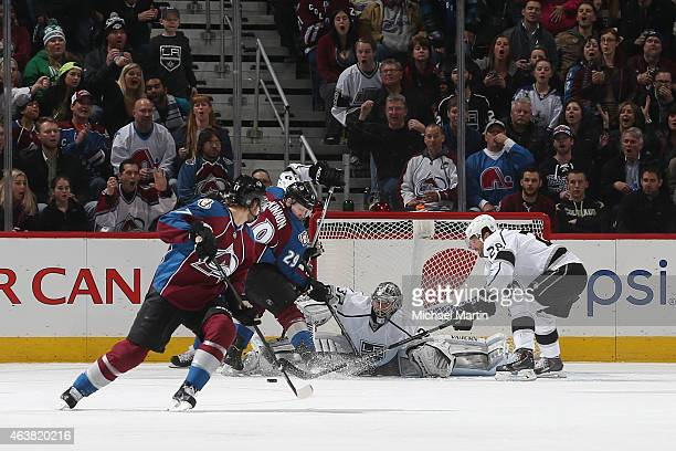 Goaltender Jonathan Quick and Jarret Stoll of the Los Angeles Kings defend the net against Nathan MacKinnon and Brad Stuart of the Colorado Avalanche...