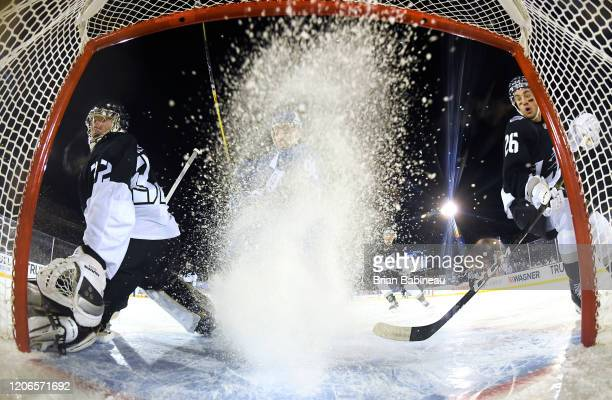 Goaltender Jonathan Quick and Sean Walker of the Los Angeles Kings defend their net during the first period of the 2020 NHL Stadium Series game...