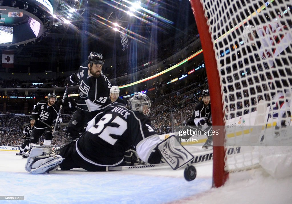 Goaltender Jonathan Quick #32 and Willie Mitchell #33 of the Los Angeles Kings fail to stop the goal by Patrik Elias #26 of the New Jersey Devils (not pictured) in the third period of Game Four of the 2012 Stanley Cup Final at Staples Center on June 6, 2012 in Los Angeles, California.