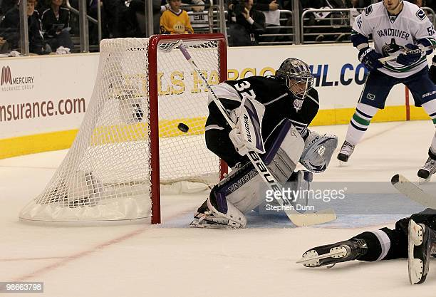 Goaltender Jonathan Quick of the Los Angeles Kings allows the go ahead goal by Daniel Sedon of the Vancouver Canucks with 203 remaining in the third...
