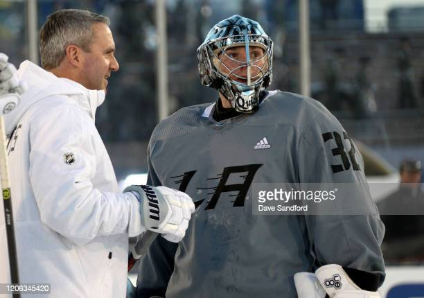 Goaltender Jonathan Quick of the Los Angeles Kings and goaltending coach Bill Ranford look on during Los Angeles Kings practice prior to the 2020 NHL...