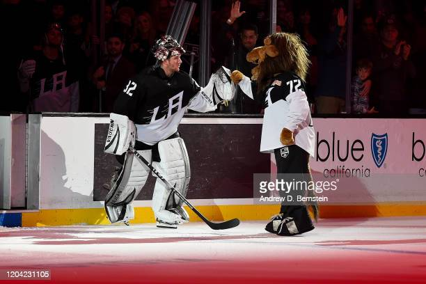 Goaltender Jonathan Quick of the Los Angeles Kings and Kings mascot Bailey fist bump as Quick is recognized as a star of the game after a 2-1...