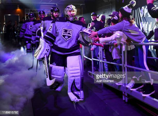 Goaltender Jonathan Quick of the Los Angeles Kings and young fans high-five as he takes the ice for the second period of the game against the Arizona...