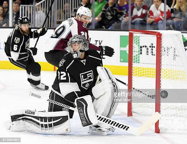 Goaltender Jonathan Quick of the Los Angeles Kings blocks a shot by Nathan MacKinnon of the Colorado Avalanche during their preseason game at TMobile...