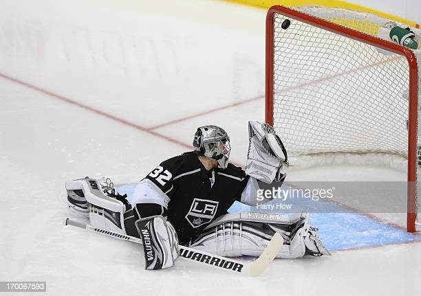 Goaltender Jonathan Quick of the Los Angeles Kings can't make the save on the shot for a goal from the top of the left faceoff circle by Marian Hossa...