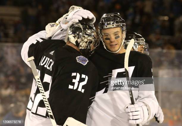 Goaltender Jonathan Quick of the Los Angeles Kings celebrates with Matt Roy on the ice after the 2020 NHL Stadium Series game between the Los Angeles...
