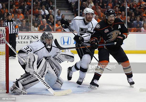Goaltender Jonathan Quick of the Los Angeles Kings defends as Jeff Schultz of the Kings and Teemu Selanne of the Anaheim Ducks fight for position in...