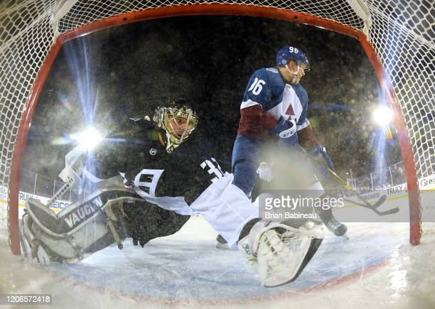 Goaltender Jonathan Quick of the Los Angeles Kings defends his net as Mikko Rantanen of the Colorado Avalanche skates in front of the net during the...