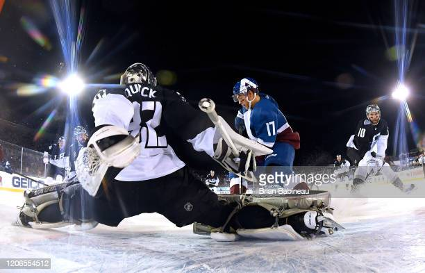 Goaltender Jonathan Quick of the Los Angeles Kings defends his net against Tyson Jost of the Colorado Avalanche during the first period of the 2020...