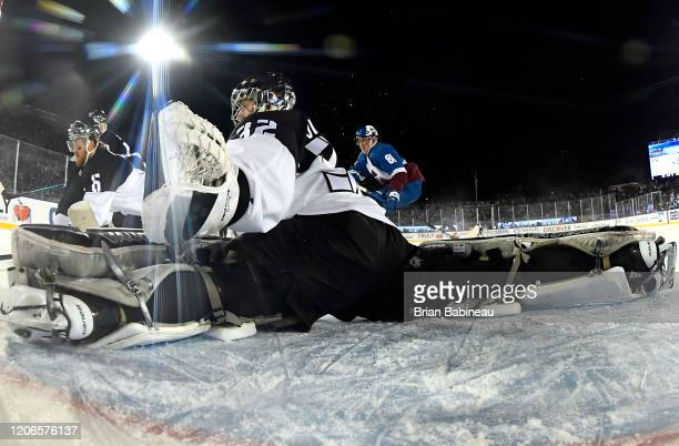 Goaltender Jonathan Quick of the Los Angeles Kings defends his net during the third period of the 2020 NHL Stadium Series game between the Los...