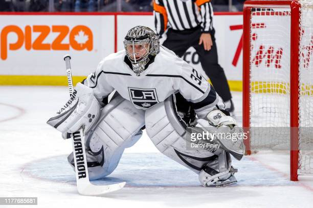 Goaltender Jonathan Quick of the Los Angeles Kings guards the net during first period action against the Winnipeg Jets at the Bell MTS Place on...