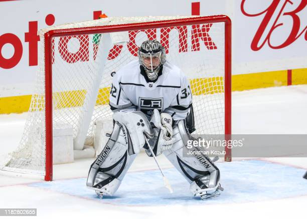 Goaltender Jonathan Quick of the Los Angeles Kings guards the net during third period action against the Winnipeg Jets at the Bell MTS Place on...
