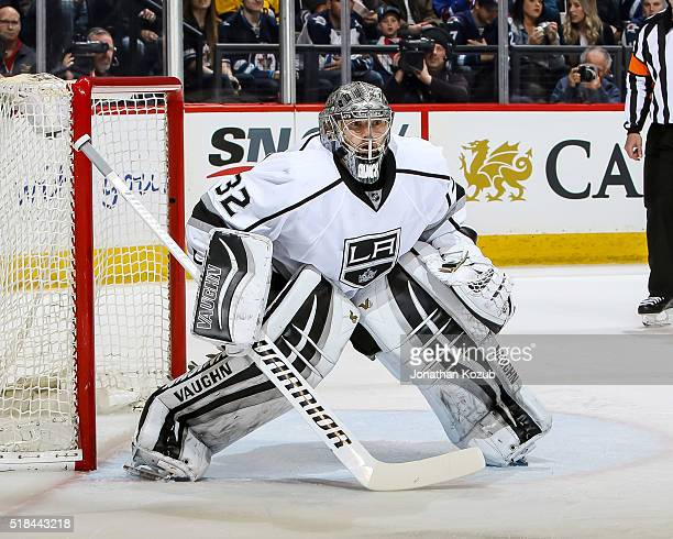 Goaltender Jonathan Quick of the Los Angeles Kings guards the net during second period action against the Winnipeg Jets at the MTS Centre on March 24...