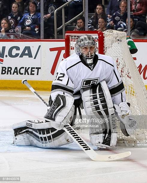 Goaltender Jonathan Quick of the Los Angeles Kings guards the net during third period action against the Winnipeg Jets at the MTS Centre on March 24...