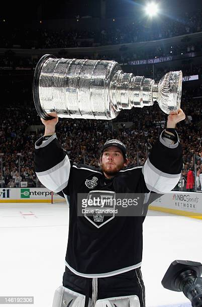 Goaltender Jonathan Quick of the Los Angeles Kings lifts the Stanley Cup after the Los Angeles Kings defeated the New Jersey Devils 6-1 in Game Six...