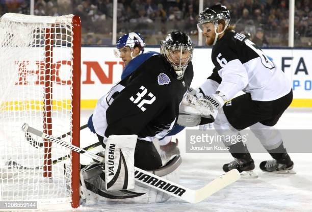 Goaltender Jonathan Quick of the Los Angeles Kings looks back behind the net during the first period of the 2020 Stadium Series game between the Los...