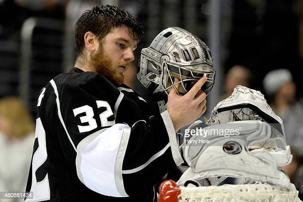 Goaltender Jonathan Quick of the Los Angeles Kings looks into his mask in the first period while taking on the New York Rangers during Game Five of...