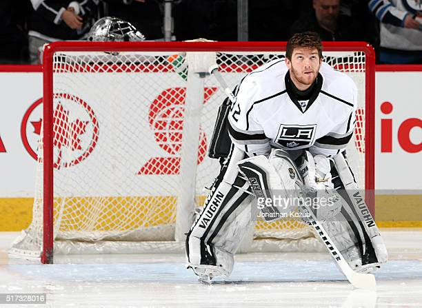 Goaltender Jonathan Quick of the Los Angeles Kings looks on from the crease prior to puck drop against the Winnipeg Jets at the MTS Centre on March...