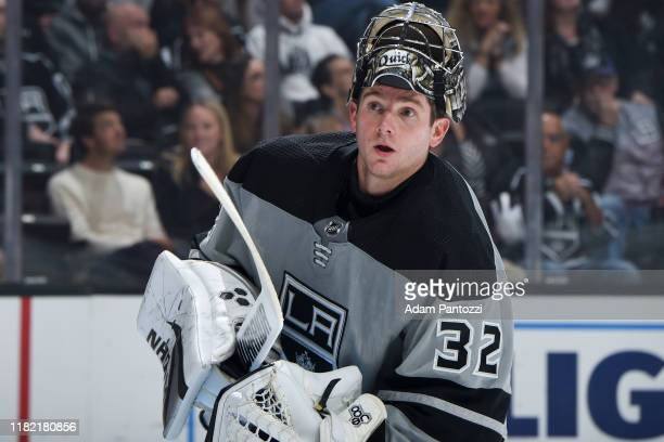 Goaltender Jonathan Quick of the Los Angeles Kings looks on while waiting for play to resume during the second period of the game against the Calgary...