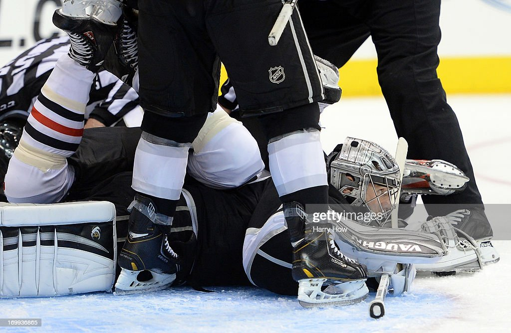 Goaltender Jonathan Quick #32 of the Los Angeles Kings looks up for the the bottom of the pile in the third period of Game Three of the Western Conference Final against the Chicago Blackhawks during the 2013 NHL Stanley Cup Playoffs at Staples Center on June 4, 2013 in Los Angeles, California. The Kings defeated the Blackhawks 3-1.