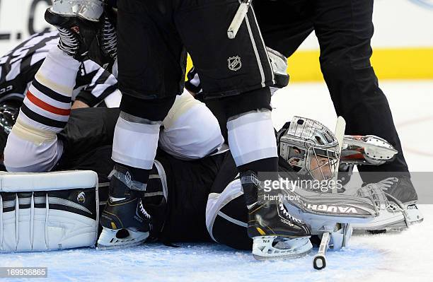 Goaltender Jonathan Quick of the Los Angeles Kings looks up for the the bottom of the pile in the third period of Game Three of the Western...